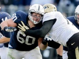Ty Howle has gone from starting center and team captain to analyst to full-time assistant with the Nittany Lions after being promoted to tight ends coach on Friday.                                  Abby Drey | AP file photo, Centre Daily Times