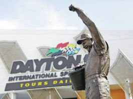 A statue of Dale Earnhardt rises above an entrance at Daytona International Speedway. The iconic driver's death in a crash at the track in 2001 forced NASCAR to take safety more seriously, and the dramatic upgrades have saved lives.                                  Lynne Sladky   AP file photo