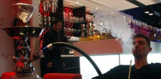 Francois Ribery, right, smokes a traditional 'Shisha,' water pipe at a hookah lounge in Boulogne-sur-Mer, northern France, on Wednesday, Jan. 4, 2012. Closer to home, Wilkes-Barre's Zoning Hearing Board Wednesday denied two applications for bottle clubs, split on hookah lounges sought by the applicants and approved an apartment complex for a vacant commercial property on Carey Avenue.