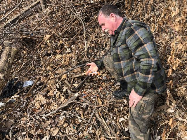 Swoyersville resident Greg Griffin, shown pointing out litter in Wilkes-Barre in this file photo, spoke during Monday's Luzerne County Cares Commission meeting about his volunteer campaign to target illegal dumping and help low-income residents insulate their homes.                                  Times Leader file photo