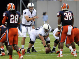 Ty Howle (60) played his first game as a Penn State captain as the center for true freshman quarterback Christian Hackenberg against Syracuse in 2013. Now Howle is getting started as the Nittany Lions' new tight ends coach.                                  Bill Kostroun | AP file photo