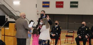 While David Gutowski took an oath to become a newly promoted captain in the Wilkes-Barre City Fire Department, his 3-year-old daughter Mia leaned in and paid close attention to Mayor George Brown.                                  Jerry Lynott   Times Leader
