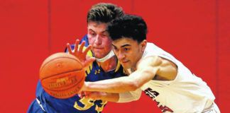 Vally View's TJ Noto (left) and Crestwood's Marcus Vieney go after a lose ball during Tuesday's District 2 Class 5A semifinal game.                                  Fred Adams | For Times Leader