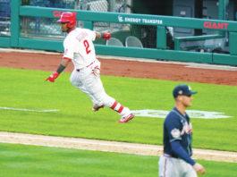 The Phillies' Jean Segura, left, reacts after hitting a game-winning RBI-single off Atlanta Braves reliever Nate Jones during the 10th inning of Thursday's opener in Philadelphia.                                  Matt Slocum | AP photo