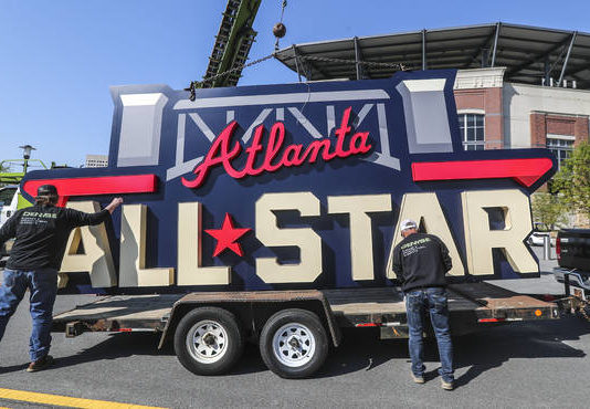 Workers load an All-Star sign onto a trailer after it was removed from Truist Park in Atlanta on Tuesday. MLB has moved this summer's All-Star Game from Atlanta to Denver in response to recent voting laws passed in Georgia.                                  John Spink | AP photo, Atlanta Journal-Constitution
