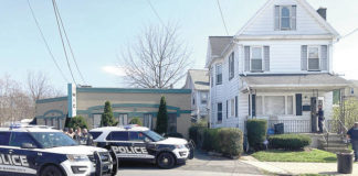 Wilkes-Barre police outside 236 Carey Ave. on Wednesday. Kevin Carroll | Times Leader