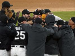 White Sox players mob pitcher Carlos Rodón, center, after he completed his no-hitter on Wednesday against Cleveland. Rodón allowed just one baserunner, losing a perfect game when he hit a batter in the foot with one out in the ninth inning.                                  David Banks | AP photo