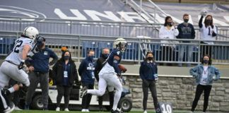 Cornerback Kalen King scored the first touchdown of Saturday's scrimmage, coming up with a pick-six of a Ta'Quan Roberson pass.                                  Penn State Athletics