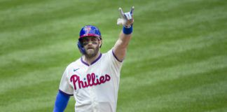 The Philadelphia Phillies' Bryce Harper gestures after crossing the plate on a home run during the first inning of a game against the St. Louis Cardinals on Sunday in Philadelphia.                                  AP photo