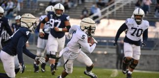 Penn State wideout Jahan Dotson (5) shakes off Kalen King (4) and breaks free for a long touchdown during a scrimmage Friday at Beaver Stadium.                                  Penn State Athletics
