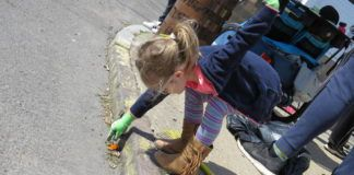 Charlie Frey, 4, picks up a piece of plastic across from Tony's Meat Market in Wilkes-Barre during the Great American Cleanup Saturday.                                  Marcella Kester | For Times Leader