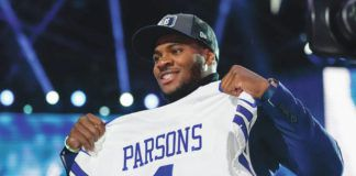 Penn State linebacker Micah Parsons holds a Cowboys jersey after the was chosen with the No. 10 overall pick on Thursday.                                  Tony Dejak   AP photo
