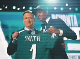 Alabama wide receiver DeVonta Smith holds up his new Eagles jersey with commissioner Roger Goodell after Philadelphia made last season's Heisman Trophy winner the No. 10 overall pick.                                  Tony Dejak | AP photo