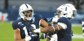 Penn State defensive end Shaka Toney, left, was a first-team All-Big Ten selection as a senior in 2020.                                  Barry Reeger   AP file photo