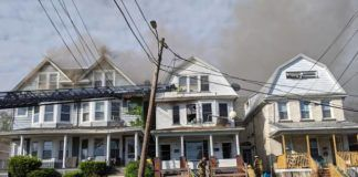 City firefighters battled a blaze that heavily damaged three structures on Dana Street Friday morning.