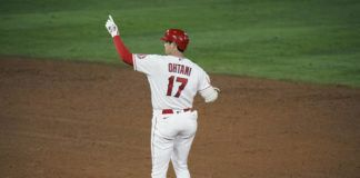 The Los Angeles Angels' Shohei Ohtani, of Japan, celebrates his RBI double during the sixth inning of a game against the Los Angeles Dodgers in Anaheim, Calif.                                  AP photo