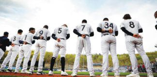 The Scranton/Wilkes-Barre RailRiders line up for the national anthem before Tuesday's home opener in Moosic.                                  Fred Adams | For Times Leader