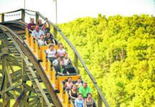 The Phoenix roller coaster is seen at Knoebels Amusement Resort in Elysburg is seen in this file photo. Knoebels said Friday that while people who are fully vaccinated can go maskless outside, masks will still be required indoors.                                  File photo