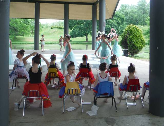 <p>Some of the youngest dancers await their turn to take the stage, while more experienced performers dance with garlands of flowers.</p>                                  <p>Mary Therese Biebel   Times Leader</p>