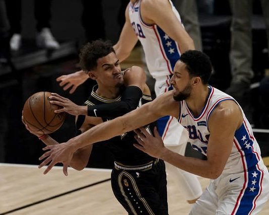 Hawks star Trae Young (11) finished with 34 points, but it wasn't enough to pull off a third straight fourth-quarter comeback against the Sixers on Friday.                                  John Bazemore   AP photo