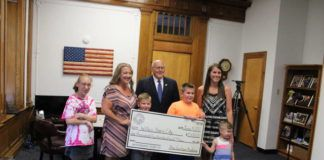 The Graham Academy presented Wilkes-Barre Mayor George Brown with a $1,500 check for the construction of the special needs playground in Kirby Park. From left to right are: Morgan Qualters, Beth Qualters, president of the schools PTO, Mason Qualters, Brown, Breyson Kovalick, Brynn Kovalick, treasurer of the PTO, and Landon Kovalick.                                  Jerry Lynott | Times Leader