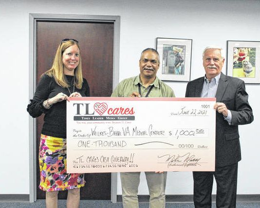 The Wilkes-Barre VA Medical Center was presented with $1,000 from the TL Cares program. The VA was selected by $1,000 weekly winner Anthony Martini to receive the donation. Pictured, from left: Kerry Miscavage, Times Leader vice president of sales and marketing; Louis Smyth, VA voluntary services assistant; and Mike Murray, Times Leader publisher.