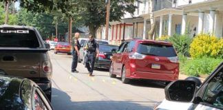 Wilkes-Barre police are seen investigating a minivan that was shot up on Sambourne Street late Friday morning.                                  Jerry Lynott   Times Leader