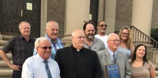 """Monsignor Michael Delaney recently bid farewell to Olyphant after serving nine years at Holy Cross Church/St. Patrick's Church. The Olyphant Borough Council and the mayor extended their gratitude with a plaque in his honor, which read in part, """"you will always be a part of our town."""" Monsignor Delaney, who also served as pastor of Blessed Sacrament Church in Throop, is now going to serve Our Lady of Snows Roman Catholic Church in Clarks Summit. Shown from left are, first row: Olyphant Mayor John Sedlak, Monsignor Michael Delaney and Olyphant Council Members: Robert Hudak and Dina Harrington. Second row: Dave Krukovitz, Gerald Tully, James Baldan, Michael Adda, and Beth Frushon."""