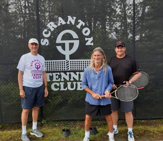 John Weiss, tournament director poses with the Men's Singles 50 and Older finalists: Phil Mercurio, champion; John Sinclair, runner-up.