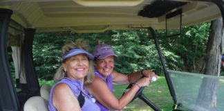 Marie Milhalos of Pittston and Donna Long of Wyoming prepare to drive to the next hole at the Wyoming Valley Country Club.                                  Mary Therese Biebel   Times Leader