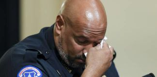 U.S. Capitol Police Sgt. Harry Dunn wipes his eye as he testifies during the House select committee hearing on the Jan. 6 attack on Capitol Hill in Washington on Tuesday.                                  Oliver Contreras   The New York Times via AP
