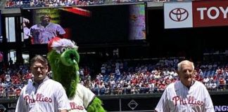Joe Yudichak Sr., right, walks off the mound after he delivered the first pitch at a recent Philadelphia Phillies game at Citizens Bank Park. His son, state Sen. John Yudichak, left, and the Phillie Phanatic, who caught the pitch, help celebrate.                                  Submitted Photo