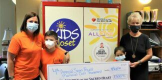 Shown from left are: Shelly Powell, wife of Sean Powell, Lucas and Lily Powell, son and daughter of Sean and Shelly Powell, and Diane Baldi, CEO, Hospice of the Sacred Heart.                                  Submitted photo