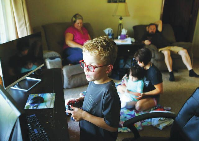 <p>Thomas Satterfield, 8, plays Minecraft as his family hangs out at their home in Kokomo, Ind. Video games are made for entertainment, of course, but they give parents opportunities to talk about saving and spending. Some financial literacy experts actually use video games to teach kids about money. Video game currency costs real money, and you can give your kids real chores to earn it. And the games themselves offer chances for kids to explore how businesses are run and how to budget so they don't run out of that hard-earned currency right away.</p>                                  <p>AP file photo</p>