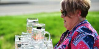 Heidi Gowden, of Moosic, carries plastic beer steins full of water during a competiton at Susquehanna Brewing Company's Oktoberfest in Pittston in 2017. CouldOktoberfest be coming to Wilkes-Barre? Mayor George Brown has raised the possibility, and it's an idea the Times Leader supports.                                  Times Leader file photo