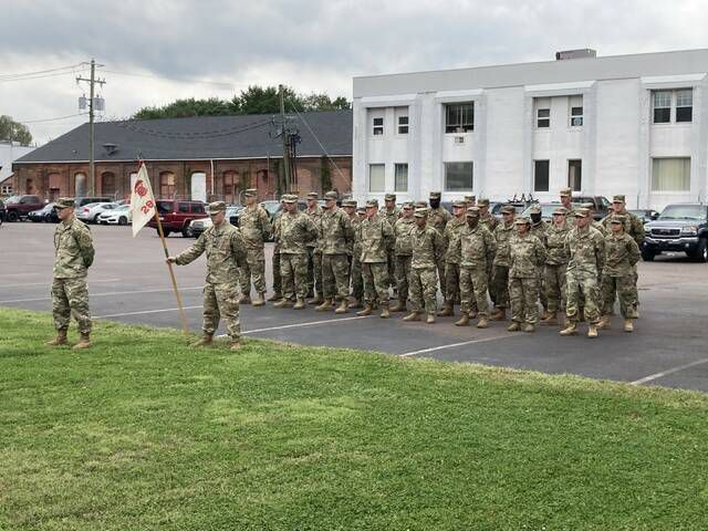 <p>Soldiers from the 109th Field Artillery stand at attention before Sunday's ceremony, held at the 109th Field Artillery Armory in Wilkes-Barre.</p>                                  <p>Kevin Carroll   Times Leader</p>