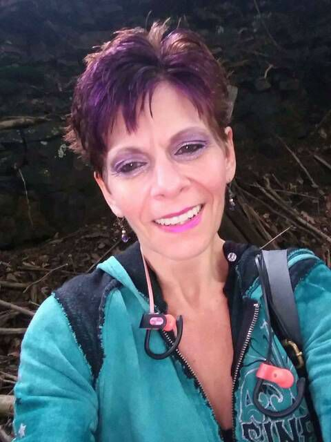 Judith Comisky is seen in a photo from her Facebook profile. Comisky, 52, was found dead in her Willow Street home on Thursday.