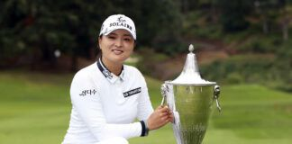 Jin Young Ko, of South Korea, poses with the trophy after winning the LPGA Cambia Portland Classic in West Linn, Ore., on Sunday.                                  AP photo