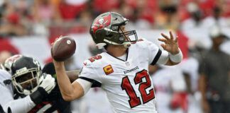 Tampa Bay Buccaneers quarterback Tom Brady fires a pass against the Atlanta Falcons during the first half of an NFL game Sunday in Tampa, Fla.                                  AP photo