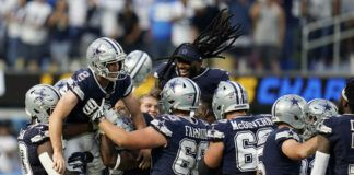 Dallas Cowboys kicker Greg Zuerlein is lifted by teammates after making the game-winning field goal as time expired during the second half of an NFL game against the Los Angeles Chargers on Sunday in Inglewood, Calif.                                  AP photo