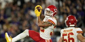 Kansas City Chiefs free safety Tyrann Mathieu, left, intercepts a pass attempt in front of teammate Ben Niemann in the first half of an NFL game against the Baltimore Ravens on Sunday in Baltimore.                                  AP photo