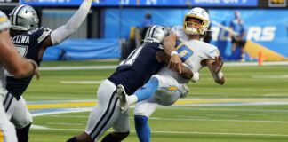 Los Angeles Chargers quarterback Justin Herbert is hit by Dallas Cowboys linebacker Micah Parsons as he throws during the second half of an NFL game Sunday in Inglewood, Calif.                                  AP photo