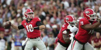 Georgia quarterback JT Daniels (18) throws a pass against South Carolina during the first half of an NCAA football game Saturday in Athens, Ga.                                  AP photo
