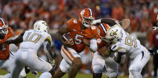 Clemson quarterback D.J. Uiagalelei (5) runs through the line as Georgia Tech's Ayinde Eley (10) and D'Quan Douse (99) close in during the second half of an NCAA football game on Saturday in Clemson, S.C.                                  AP photo