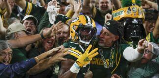 The Green Bay Packers' Aaron Jones celebrates his touchdown run during the second half of an NFL game against the Detroit Lions on Monday in Green Bay, Wis.                                  AP photo