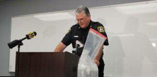 Wilkes-Barre City Police Chief Joseph Coffay delivers a press conference while standing over a table full of drugs seized by police.                                  Patrick Kernan   Times Leader