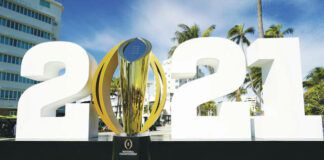 The trophy for the College Football Playoff championship NCAA football game is displayed along Ocean Drive, in Miami Beach, Fla.                                  AP photo