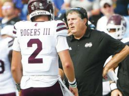 Mississippi State coach Mike Leach, right, talks to Mississippi State quarterback Will Rogers during the first half of an NCAA football game against Memphis on Saturday in Memphis, Tenn.                                  AP photo