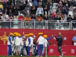 Team Europe wears cheeseheads on the first tee during a practice day at the Ryder Cup at the Whistling Straits Golf Course on Wednesday in Sheboygan, Wis.                                  AP photo