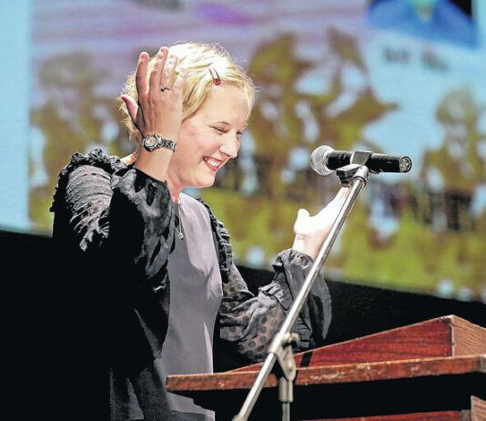 Paint Pittston Pink President and Co-Founder Barb Sciandra breaks out in laughter during her remarks at a 2018 event. Sciandra talked with the Times Leader about her journey as a cancer survivor, as well as about the success of PPP and organizing this year's event amid the ongoing pandemic.                                  Times Leader file photo